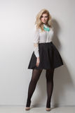Beautiful blonde with long hair in a skirt. thick. Royalty Free Stock Photo
