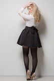 Beautiful blonde with long hair in a skirt. thick. Stock Photo