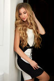 Beautiful blonde with long wavy hair.  Royalty Free Stock Photos