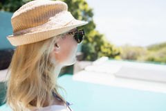 Beautiful blonde looking at the pool Stock Images
