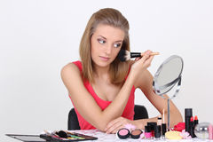 Beautiful blonde with make up brushes and accessories Royalty Free Stock Photography