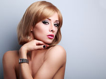 Beautiful blonde makeup female model posing in fashion watches o Royalty Free Stock Photography