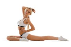 Beautiful blonde is making exercises Royalty Free Stock Photography