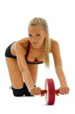 Beautiful blonde is making gym exercises Stock Image