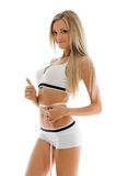 Beautiful blonde is measuring her waist Royalty Free Stock Images