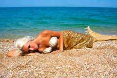 Beautiful blonde mermaid Stock Photography