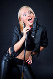 Beautiful blonde with a microphone Stock Image