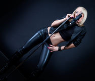 Beautiful blonde with a microphone Stock Photography