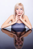 Beautiful blonde and mirror Stock Photography