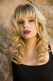 Beautiful blonde model. In a black tank top Royalty Free Stock Image