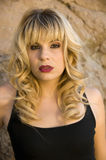 Beautiful blonde model. In a black tank top Stock Photo