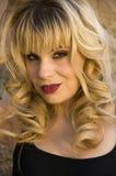 Beautiful blonde model. In a black tank top Stock Photos