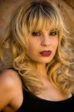 Beautiful blonde model. In a black tank top Stock Image