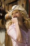 Beautiful blonde model. In a cowboy hat Stock Images