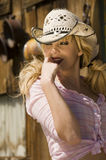 Beautiful blonde model. In a cowboy hat Stock Photography