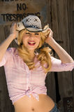Beautiful blonde model. In a cowboy hat Royalty Free Stock Photos