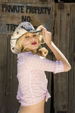 Beautiful blonde model. In a cowboy hat Stock Photos