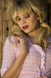 Beautiful blonde model. In a pink blouse Stock Images