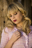 Beautiful blonde model. In a pink blouse Royalty Free Stock Photography