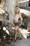 Beautiful blonde model. In a pink blouse and a cowboy hat Stock Images