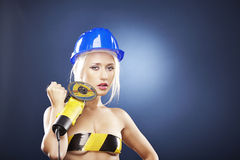 Beautiful blonde model with angle grinder Stock Photos