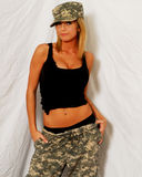 Beautiful Blonde Model in Camouflage. Stock Photo
