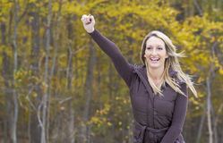 Beautiful Blonde Model Cheering Royalty Free Stock Photography