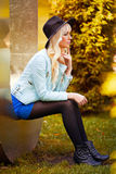 Beautiful blonde model in dress outdoors Stock Images