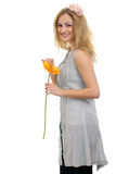 Beautiful blonde model with a flower 2 Royalty Free Stock Photography