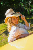 Beautiful blonde model in a straw cowboy hat. Stock Photos