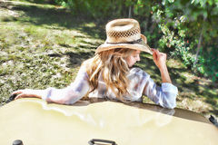 Beautiful blonde model in a straw cowboy hat. Royalty Free Stock Photo