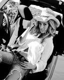 Beautiful blonde model in a straw cowboy hat. Stock Photo