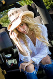 Beautiful blonde model in a straw cowboy hat. Royalty Free Stock Image