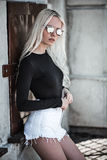 Beautiful blonde model in sunglassses outside Royalty Free Stock Photography