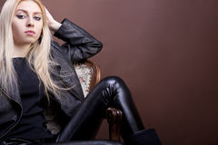 Beautiful blonde model in a vintage chair Royalty Free Stock Image