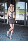 Beautiful blonde model walking outdoors Royalty Free Stock Photography