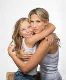 Beautiful blonde mother and daughter embrance each other Royalty Free Stock Image