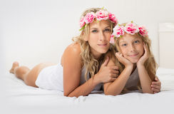 Beautiful blonde mother and daughter together Royalty Free Stock Photos