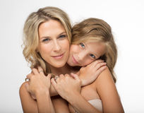 Beautiful blonde mother and her daughter together royalty free stock photography
