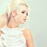 Beautiful blonde with mysterious look. Royalty Free Stock Photography
