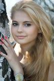 Beautiful blonde near the birch Stock Photo