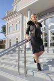 Beautiful blonde near building Stock Photo