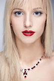 Beautiful blonde in necklace Stock Photo