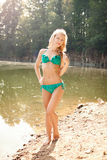Beautiful blonde next to a lake Royalty Free Stock Images