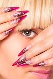 Beautiful blonde with a nice manicure Royalty Free Stock Photo