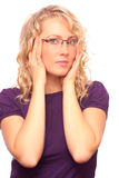 The beautiful blonde in the optical salon Royalty Free Stock Image