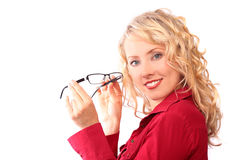 The beautiful blonde in the optical salon Royalty Free Stock Photography