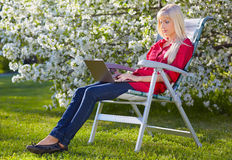 Beautiful blonde outdoors Stock Image