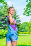 Beautiful  blonde in a overalls invites to follow her Stock Photos