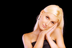 Beautiful blonde with palms at face Royalty Free Stock Images